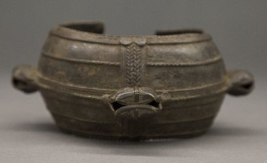 Akan. <em>Bracelet</em>, 19th century or earlier. Copper alloy, 2 1/2 x 5 in. (6.4 x 12.7 cm). Brooklyn Museum, Gift of Drs. John I. and Nicole Dintenfass, 1996.199.4. Creative Commons-BY (Photo: Brooklyn Museum, 1996.199.4_PS10.jpg)