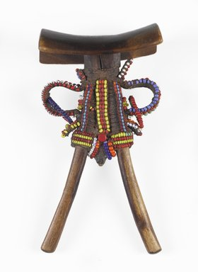 Samburu. <em>Headrest</em>, 20th century. Wood, glass beads, leather, wire, 7 x 3 3/4 in.  (17.8 x 9.5 cm). Brooklyn Museum, Gift of Donna Klumpp Pido, 1996.204.2. Creative Commons-BY (Photo: Brooklyn Museum, 1996.204.2_PS9.jpg)