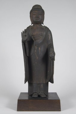 <em>Yakushi Nyorai (Bhaishajyaguru), the Buddha of Healing</em>, 12th century. Wood with traces of lacquer, 21 1/4 (without tenon) x 8 x 6 1/2in. (54 x 20.3 x 16.5cm). Brooklyn Museum, Gift of Dr. Helen Boigon, 1996.209. Creative Commons-BY (Photo: Brooklyn Museum, 1996.209_PS5.jpg)