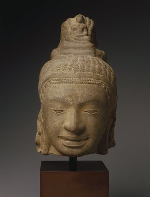 <em>Head of a Male Divinity, Prei Khmeng Style</em>, 540-600 C.E. Gray sandstone, 10 x 5 3/4 x 6 1/2 in. Brooklyn Museum, Gift of Georgia and Michael de Havenon, 1996.210.3. Creative Commons-BY (Photo: Brooklyn Museum, 1996.210.3_SL1.jpg)