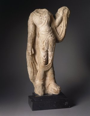 <em>Torso of a Bodhisattva</em>, 7th-8th century. Limestone, traces of polychrome, 13 x 22 x 6 x 23 1/2 in., 36.5 lb. (33 x 55.9 x 15.2 x 59.7 cm, 16.56kg). Brooklyn Museum, Gift of Mr. and Mrs. Robert L. Poster, 1996.217. Creative Commons-BY (Photo: Brooklyn Museum, 1996.217_SL1.jpg)