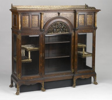 Herts Brothers. <em>Cabinet</em>, ca. 1885. Faux-grained Rosewood, other woods, glass, alabaster, brass, mother-of-pearl, other metals, original velvet textile and trim on interior, 54 3/4 x 58 7/8 x 17 1/4 in. (139.1 x 149.5 x 43.8 cm). Brooklyn Museum, Gift of David Whitcomb, 1996.218. Creative Commons-BY (Photo: Brooklyn Museum, 1996.218_threequarter_PS1.jpg)