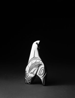 Pat McGuire (Haida). <em>Pendant in the Form of a Killer Whale</em>, 1970. Argillite, 2 1/8 x 1 1/4 in.  (5.4 x 3.2 cm). Brooklyn Museum, Gift of Mr. and Mrs. Alastair B. Martin, the Guennol Collection, 1996.23.1. Creative Commons-BY (Photo: Brooklyn Museum, 1996.23.1_bw.jpg)