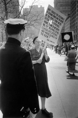 Vivian Cherry (American, 1920-2019). <em>Dorothy Day, City Hall Park Marching Against the Atom Bomb</em>, 1959. Gelatin silver photograph (vintage), image: 6 7/8 x 10 3/16 in. (17.5 x 25.9 cm). Brooklyn Museum, Gift of Steven Schmidt, 1996.241.13. © artist or artist's estate (Photo: Brooklyn Museum, 1996.241.13_bw.jpg)