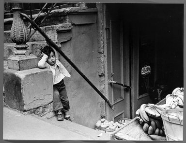 Vivian Cherry (American, 1920-2019). <em>Lower East Side N.Y.C (Child on Stairs with Bananas and Potatoes)</em>, ca. 1950s. Gelatin silver photograph, 9 1/2 x 12 1/2 in. (24.2 x 31.6 cm). Brooklyn Museum, Gift of Steven Schmidt, 1996.241.1. © artist or artist's estate (Photo: Brooklyn Museum, 1996.241.1_bw.jpg)