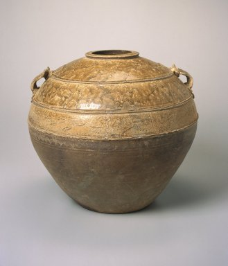 <em>Storage Jar</em>, 206 B.C.E.-220 C.E. Proto-Yue ware, stoneware with natural ash glaze, 13 1/4 x 15 3/8 in. (33.7 x 39.1 cm). Brooklyn Museum, Gift of Dr. and Mrs. George J. Fan, 1996.26.1. Creative Commons-BY (Photo: Brooklyn Museum, 1996.26.1_SL1.jpg)