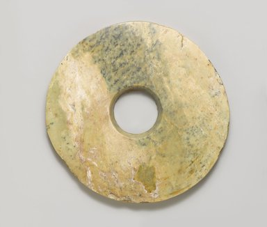 <em>Ritual Disk (Bi)</em>. Jade (nephrite), 3/8 x 6 1/8 in. (1 x 15.6 cm). Brooklyn Museum, Gift of Robert H. Ellsworth, 1996.71.3. Creative Commons-BY (Photo: Brooklyn Museum, 1996.71.3_PS4.jpg)