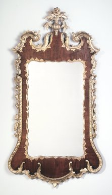 <em>Looking Glass</em>, ca.1740-1780. Mahogany, walnut veneer, spruce, gilt, 56.5 x 29.5 x 3.25 in.  (143.5 x 74.9 x 8.3 cm). Brooklyn Museum, Matthew Scott Sloan Collection, Gift of Lidie Lane Sloan McBurney, 1997.150.23. Creative Commons-BY (Photo: Brooklyn Museum, 1997.150.23_transp696.jpg)