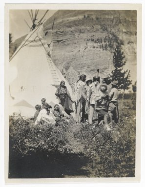 Unknown. <em>[Untitled] (Informal Family Group beside a Teepee)</em>, ca. 1900. Gelatin silver photograph, 2 7/8 x 3 7/8 in. (7.4 x 9.8 cm). Brooklyn Museum, Gift of Sasha Nyary and Family, 1997.163.2 (Photo: Brooklyn Museum, 1997.163.2_PS2.jpg)