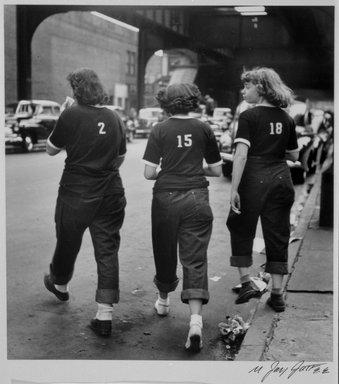 N. Jay Jaffee (American, 1921-1999). <em>Three Girls Crossing Street (Livonia Avenue Under IRT New Lots El, East New York)</em>, 1950; printed 1995. Selenium-toned gelatin silver photograph, image: 6 1/2 x 6 1/8 in. (16.5 x 15.6 cm). Brooklyn Museum, Gift of Paula W. Hackeling, 1997.164.16. © artist or artist's estate (Photo: Brooklyn Museum, 1997.164.16_bw.jpg)