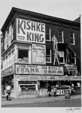 N. Jay Jaffee (American, 1921-1999). <em>Kishke King (Pitkin Avenue, Brownsville)</em>, 1953; printed 1995. Selenium-toned gelatin silver photograph, image: 8 1/2 x 6 1/2 in. (21.6 x 16.5 cm). Brooklyn Museum, Gift of Paula W. Hackeling, 1997.164.33. © artist or artist's estate (Photo: Brooklyn Museum, 1997.164.33_bw.jpg)