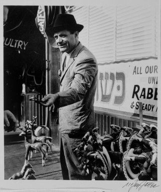 N. Jay Jaffee (American, 1921-1999). <em>Man Selling Watch (Blake Avenue, East New York)</em>, 1949; printed 1995. Selenium-toned gelatin silver photograph, image: 6 5/16 x 5 7/16 in. (16 x 13.8 cm). Brooklyn Museum, Gift of Paula W. Hackeling, 1997.164.8. © artist or artist's estate (Photo: Brooklyn Museum, 1997.164.8_bw.jpg)