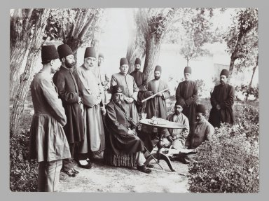 <em>Mozaffar al-Din Shah and Attendants Seated in a Garden,  One of 274 Vintage Photographs</em>, late 19th-early 20th century. Gelatin silver printing out paper, 4 5/8 x 6 1/4 in.  (11.7 x 15.9 cm). Brooklyn Museum, Purchase gift of Leona Soudavar in memory of Ahmad Soudavar, 1997.3.105 (Photo: Brooklyn Museum, 1997.3.105_IMLS_PS3.jpg)