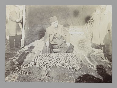 <em>Mozaffar al-Din Shah Seated above a Hunted Leopard, One of 274 Vintage Photographs</em>, late 19th-early 20th century. Gelatin silver printing on paper, 4 7/16 x 6 1/8 in.  (11.3 x 15.6 cm). Brooklyn Museum, Purchase gift of Leona Soudavar in memory of Ahmad Soudavar, 1997.3.106 (Photo: Brooklyn Museum, 1997.3.106_IMLS_PS3.jpg)