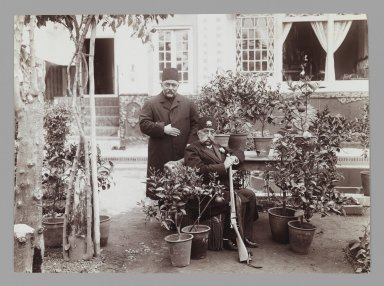 <em>Mozaffar al-Din Shah with Amin al-Soltan in Garden, One of 274 Vintage Photographs</em>, late 19th-early 20th century. Gelatin silver printing out paper, 4 5/8 x 6 5/16 in.  (11.7 x 16.0 cm). Brooklyn Museum, Purchase gift of Leona Soudavar in memory of Ahmad Soudavar, 1997.3.109 (Photo: Brooklyn Museum, 1997.3.109_IMLS_PS3.jpg)