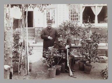 <em>Mozaffar al-Din Shah with Amin al-Soltan in Garden, One of 274 Vintage Photographs</em>, late 19th-early 20th century. Gelatin silver printing out paper, 4 5/8 x 6 5/16 in.  (11.7 x 16.0 cm). Brooklyn Museum, Purchase gift of Leona Soudavar in memory of Ahmad Soudavar, 1997.3.109 (Photo: Brooklyn Museum, 1997.3.109_IMLS_PS3.jpg)