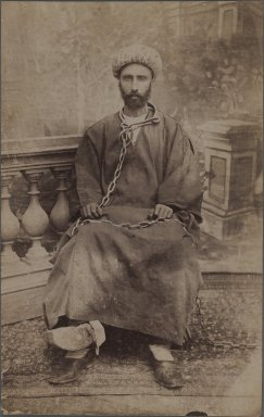 <em>A Political Prisoner in Chains</em>, late 19th-early 20th century. Albumen silver photograph, 8 1/4 x 5 1/4 in.  (21 x 13.3 cm). Brooklyn Museum, Purchase gift of Leona Soudavar in memory of Ahmad Soudavar, 1997.3.112 (Photo: Brooklyn Museum, 1997.3.112_IMLS_PS3.jpg)