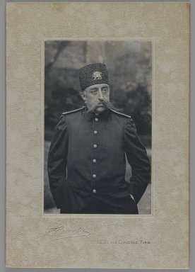 <em>A Carte de Visite with Portrait of Mozaffar al-Din Shah , One of 274 Vintage Photographs</em>, late 19th-early 20th century. Gelatin silver printing out paper mounted on carte de visite, Photograph: 3 13/16 x 2 7/16 in. (9.7 x 6.2 cm). Brooklyn Museum, Purchase gift of Leona Soudavar in memory of Ahmad Soudavar, 1997.3.128 (Photo: Brooklyn Museum, 1997.3.128_IMLS_PS3.jpg)