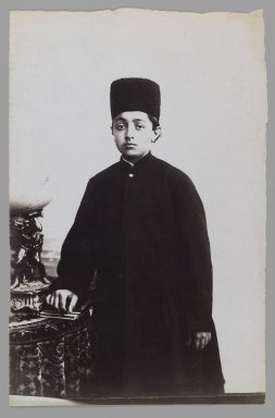 <em>Young Prince with his Hand on a Book, One of 274 Vintage Photographs</em>, late 19th-early 20th century. Albumen silver photograph, 8 1/2 x 5 1/2 in.  (21.6 x 14.0 cm). Brooklyn Museum, Purchase gift of Leona Soudavar in memory of Ahmad Soudavar, 1997.3.132 (Photo: Brooklyn Museum, 1997.3.132_IMLS_PS3.jpg)