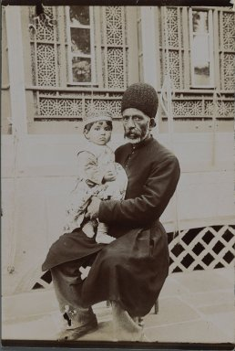 <em>Dowlet Morad Bek & child (Torkmen),  One of 274 Vintage Photographs</em>, late 19th-early 20th century. Gelatin silver printing out paper, 7 1/8 x 4 13/16 in.  (18.1 x 12.2 cm). Brooklyn Museum, Purchase gift of Leona Soudavar in memory of Ahmad Soudavar, 1997.3.135 (Photo: Brooklyn Museum, 1997.3.135_IMLS_PS3.jpg)