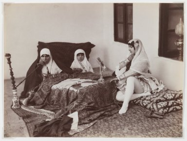 Antoin Sevruguin. <em>Two Ladies and a Child Reposing in the Harem</em>, late 19th century. Albumen silver photograph, 6 3/16 x 8 3/16 in.  (15.7 x 20.8 cm). Brooklyn Museum, Purchase gift of Leona Soudavar in memory of Ahmad Soudavar, 1997.3.14 (Photo: Brooklyn Museum, 1997.3.14_IMLS_PS3.jpg)