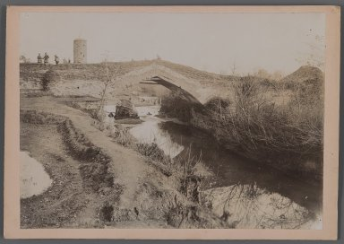 <em>View of a River with Bridge-Tower of Patterned Brickwork, One of 274 Vintage Photographs</em>, late 19th-early 20th century. Gelatin silver printing out paper, Photo:  6 7/16 x 9 1/16 in.  (16.4 x 23.0 cm);. Brooklyn Museum, Purchase gift of Leona Soudavar in memory of Ahmad Soudavar, 1997.3.168 (Photo: Brooklyn Museum, 1997.3.168_IMLS_PS3.jpg)