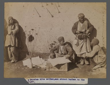<em>A Persian Kite Seller and Street Barber,  One of 274 Vintage Photographs</em>, late 19th-early 20th century. Albumen silver photograph, 6 1/8 x 8 3/16 in.  (15.5 x 20.8 cm). Brooklyn Museum, Purchase gift of Leona Soudavar in memory of Ahmad Soudavar, 1997.3.184 (Photo: Brooklyn Museum, 1997.3.184_IMLS_PS3.jpg)