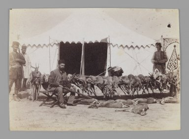 <em>Prince Abdul Husayn Mirza (Farma Farmaian) Seated before Hunted Gazelles, One of 274 Vintage Photographs</em>, late 19th-early 20th century. Albumen silver photograph, 4 3/4 x 6 5/8 in.  (12.1 x 16.9 cm). Brooklyn Museum, Purchase gift of Leona Soudavar in memory of Ahmad Soudavar, 1997.3.207 (Photo: Brooklyn Museum, 1997.3.207_IMLS_PS3.jpg)