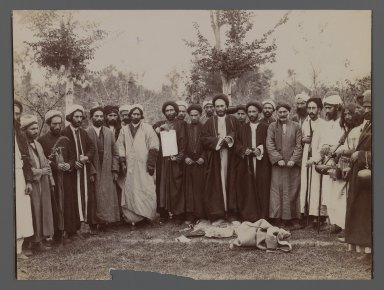 <em>A Group of Religious Men in Religious Garb  holding up a Piece of Calligraphy, One of 274 Vintage Photographs</em>, late 19th-early 20th century. Gelatin silver printing out paper, 6 7/16 x 9 7/16 in.  (16.4 x 23.9 cm). Brooklyn Museum, Purchase gift of Leona Soudavar in memory of Ahmad Soudavar, 1997.3.235 (Photo: Brooklyn Museum, 1997.3.235_IMLS_PS3.jpg)