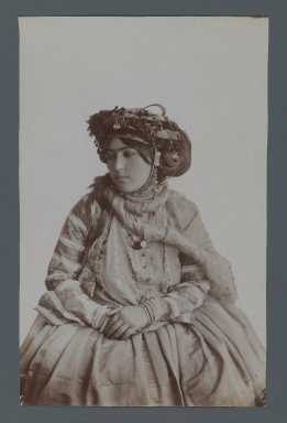 <em>Young Girl in Tribal Costume, One of 274 Vintage Photographs</em>, late 19th-early 20th century. Albumen silver photograph, 8 1/4 x 5 1/4 in.  (20.9 x 13.3 cm). Brooklyn Museum, Purchase gift of Leona Soudavar in memory of Ahmad Soudavar, 1997.3.34 (Photo: Brooklyn Museum, 1997.3.34_IMLS_PS3.jpg)