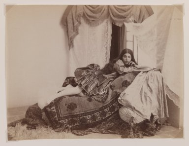 Possibly Antoin Sevruguin. <em>Studio Shot of a Reclining Lady Reading a Book</em>, late 19th century. Albumen silver photograph, 6 3/16 x 8 1/8 in.  (15.7 x 20.6 cm). Brooklyn Museum, Purchase gift of Leona Soudavar in memory of Ahmad Soudavar, 1997.3.6 (Photo: Brooklyn Museum, 1997.3.6_IMLS_PS3.jpg)