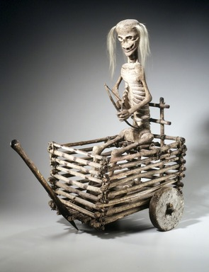 Los Hermanos Penitentes Society. <em>Death Cart</em>, 1890-1910. Wood, hide, hair, pigment, 25 1/4 x 14 x 26 1/2 in. (64.1 x 35.6 x 67.3 cm). Brooklyn Museum, Gift of Mr. and Mrs. Alastair B. Martin, the Guennol Collection, 1997.70. Creative Commons-BY (Photo: Brooklyn Museum, 1997.70_transp5516.jpg)