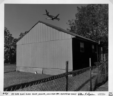 William K. Greiner (American, born 1957). <em>Jet Over Blue and Black House, Kenner, Louisiana</em>, 1994; printed 1997. Silver dye bleach photograph (Cibachrome), image: 18 1/8 x 21 7/8 in. (46.1 x 55.6 cm). Brooklyn Museum, Purchased with funds given by Ardian Gill, 1997.87.2. © artist or artist's estate (Photo: Brooklyn Museum, 1997.87.2_bw.jpg)