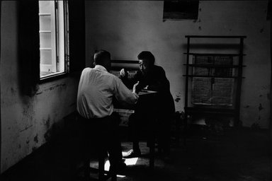 Larry Silver (American, born 1934). <em>Two Men Playing a Game, Home for the Elderly, Yangzhou City, China</em>, October 1996. Gelatin silver photograph, image: 12 3/4 x 18 1/2 in. (30.8 x 47.6 cm). Brooklyn Museum, Gift of Bruce Silverstein, 1997.99.1. © artist or artist's estate (Photo: Brooklyn Museum, 1997.99.1_bw.jpg)