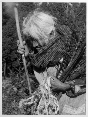 Vivian Cherry (American, 1920-2019). <em>Angangeo (Woman with Sticks)</em>, 1995. Chromogenic dye coupler photograph, image: 12 x 9 in. (30.5 x 22.9 cm). Brooklyn Museum, Gift of Steven Schmidt, 1998.10.6. © artist or artist's estate (Photo: Brooklyn Museum, 1998.10.6_bw.jpg)