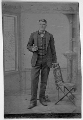 Unknown. <em>[Untitled] (Gentleman Standing Next to a Vail Folding Chair)</em>, ca. 1875. Tin type, 3 1/2 x 2 3/8 in. (8.9 x 6.0 cm). Brooklyn Museum, Gift of Robert Tuggle, 1998.121 (Photo: Brooklyn Museum, 1998.121_bw.jpg)