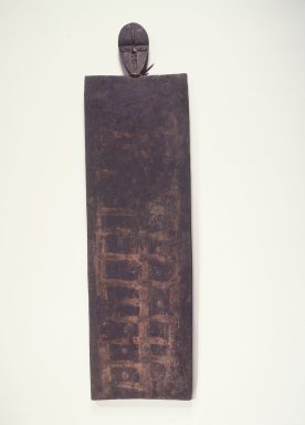 Grebo. <em>Divination Board</em>, early 20th century. Wood, pigment, 31 x 8 1/2 x 3/4 in.  (78.7 x 21.6 x 1.9 cm). Brooklyn Museum, Gift of Blake Robinson, 1998.127.9. Creative Commons-BY (Photo: Brooklyn Museum, 1998.127.9_transpc003.jpg)