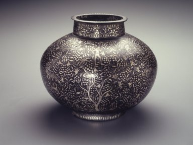 <em>Container, Bidri-ware</em>, 18th century. Copper alloy inlaid with silver decoration, 8 3/4 × 10 7/8 in., 11 lb. (22.2 × 27.6 cm, 4.99kg). Brooklyn Museum, Gift of Georgia and Michael de Havenon, 1998.132. Creative Commons-BY (Photo: Brooklyn Museum, 1998.132_transp4533.jpg)