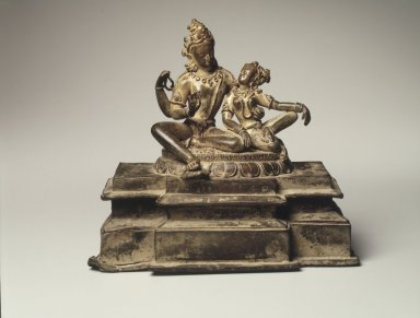 <em>Uma-Maheshvara (Shiva and His Consort Parvati)</em>, 13th century. Bronze with traces of gilding and inlaid rubies, 6 1/2 x 7 x 3 1/2 in.  (16.5 x 17.8 x 8.9 cm). Brooklyn Museum, Gift of Amy and Robert L. Poster in memory of Mahmood T. Diba, 1998.133. Creative Commons-BY (Photo: Brooklyn Museum, 1998.133_transp4534.jpg)