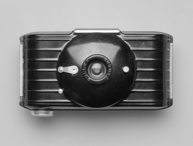 Walter Dorwin Teague (American, 1883-1960). <em>Bullet Camera</em>, ca. 1937. Bakelite, metal, glass, 2 3/4 x 4 7/8 x 1 7/8 in. (7 x 12.4 x 4.8 cm). Brooklyn Museum, Gift of Eva, Alan, and Louis Brill, 1998.143.4. Creative Commons-BY (Photo: Brooklyn Museum, 1998.143.4_front_bw.jpg)