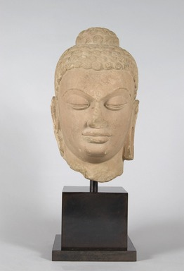 <em>Head of Buddha</em>, 5th century. Red sandstone, 13 × 7 1/2 × 7 in. (33 × 19.1 × 17.8 cm). Brooklyn Museum, Gift of Georgia and Michael de Havenon, 1998.178.4. Creative Commons-BY (Photo: Brooklyn Museum, 1998.178.4_PS5.jpg)
