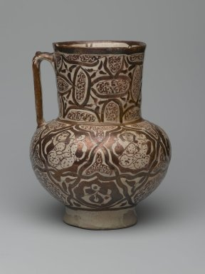 <em>Ewer</em>, early 13th century. Ceramic; fritware, molded and painted in luster on an opaque white glaze, 8 7/8 x 7 x 7 1/4 in. (22.5 x 17.8 x 18.4 cm). Brooklyn Museum, Gift of Mr. and Mrs. Paul E. Manheim, 1998.77.2. Creative Commons-BY (Photo: Brooklyn Museum, 1998.77.2_side1_PS2.jpg)