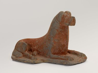 <em>Figure of a Recumbent Dog</em>, early 6th century. Gray earthenware with red polychrome, 3 5/8 x 6 1/4 x 3 5/8 in. (9.2 x 15.8 x 9.2 cm). Brooklyn Museum, Gift of the Guennol Collection, 1998.85.1. Creative Commons-BY (Photo: Brooklyn Museum, 1998.85.1_PS9.jpg)