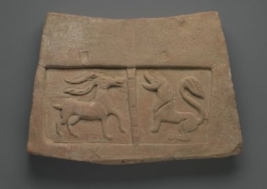 <em>Tile Relief with Antelope and Lion</em>, 5th century. Terracotta, 9 7/8 x 14 15/16 x 1 7/8 in. (25.0 x 37.7 x 5.0 cm). Brooklyn Museum, Gift of Dr. Bertram H. Schaffner, 1998.86.2. Creative Commons-BY (Photo: Brooklyn Museum, 1998.86.2_PS2.jpg)
