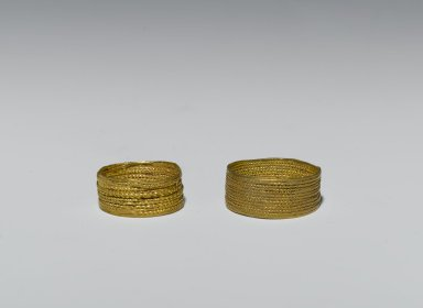Sumerian. <em>Finger Ring</em>, ca. 2600-2500 B.C.E. Gold, Diam. 3/8 in. (0.9 cm). Brooklyn Museum, Purchased with funds given by Shelby White, 1999.109.5. Creative Commons-BY (Photo: , 1999.109.4_1999.109.5_PS2.jpg)