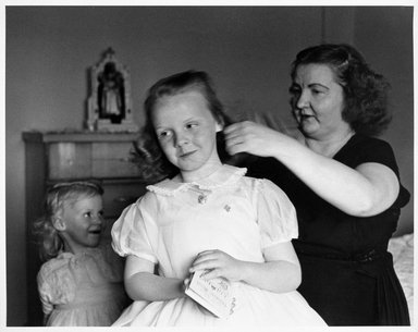 Larry Fink (American, born 1941). <em>Confirmation Day (Mother and Two Daughters)</em>, ca. early 1960s. Gelatin silver photograph, image: 15 1/8 x 19 3/8 in. (38.4 x 49.2 cm). Brooklyn Museum, Gift of Joan Snyder, 1999.128.1. © artist or artist's estate (Photo: Brooklyn Museum, 1999.128.1_bw.jpg)
