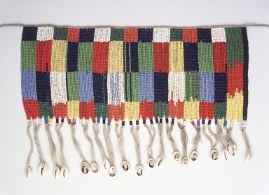 Kirdi. <em>Beaded Apron</em>, early 20th century. Colored glass beads, cotton, shells, 5 3/4 x 13 3/4 in. (14.6 x 34.9 cm). Brooklyn Museum, Gift of Mark S. Rapoport, M.D. and Jane C. Hughes, 1999.133.1. Creative Commons-BY (Photo: Brooklyn Museum, 1999.133.1_transp6032.jpg)