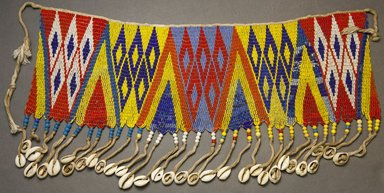 Kirdi. <em>Beaded Apron</em>, early 20th century. Colored glass beads, cotton, shells, 5 5/8 x 17 in. (14.3 x 43.2 cm). Brooklyn Museum, Gift of Mark S. Rapoport, M.D. and Jane C. Hughes, 1999.133.2. Creative Commons-BY (Photo: Brooklyn Museum, 1999.133.2_front_PS10.jpg)