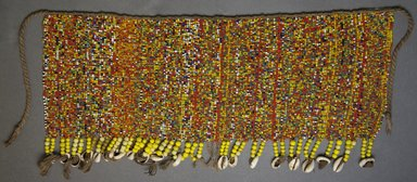 Kirdi. <em>Beaded Apron</em>, early 20th century. Colored glass beads, cotton, shells, 6 x 16 in.  (15.2 x 40.6 cm);. Brooklyn Museum, Gift of Mark S. Rapoport, M.D. and Jane C. Hughes, 1999.133.3. Creative Commons-BY (Photo: Brooklyn Museum, 1999.133.3_front_PS10.jpg)