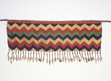 Kirdi. <em>Beaded Apron</em>, early 20th century. Colored glass beads, cotton, shells, 6 x 18 1/2 in.  (15.2 x 47.0 cm);. Brooklyn Museum, Gift of Mark S. Rapoport, M.D. and Jane C. Hughes, 1999.133.5. Creative Commons-BY (Photo: Brooklyn Museum, 1999.133.5_transp6033.jpg)